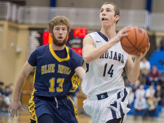 Chambersburg Cade Brindle takes a shot at the basket