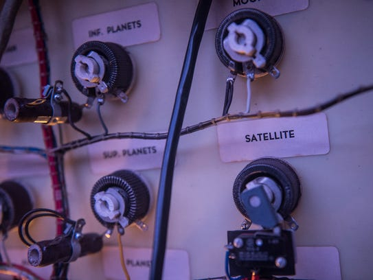 Knobs and control dials with names of the planets and
