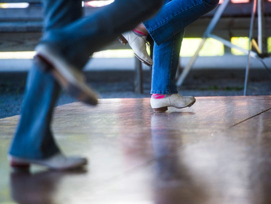 Members of the Carroll County Cloggers perform on Sunday