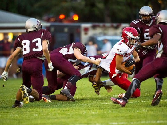 Devon Hodgen of Bermudian Springs gets tackled by Shippensburg's