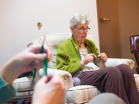 Anna Scholz, of Hanover, knits with other Compassionate