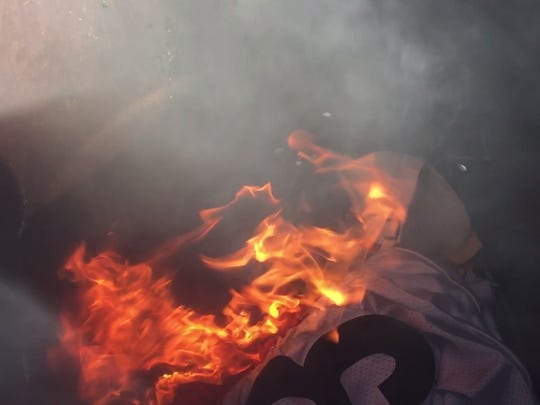 NFL merchandise is burned at Top 10 Sports Bar in Wilder, Kentucky.