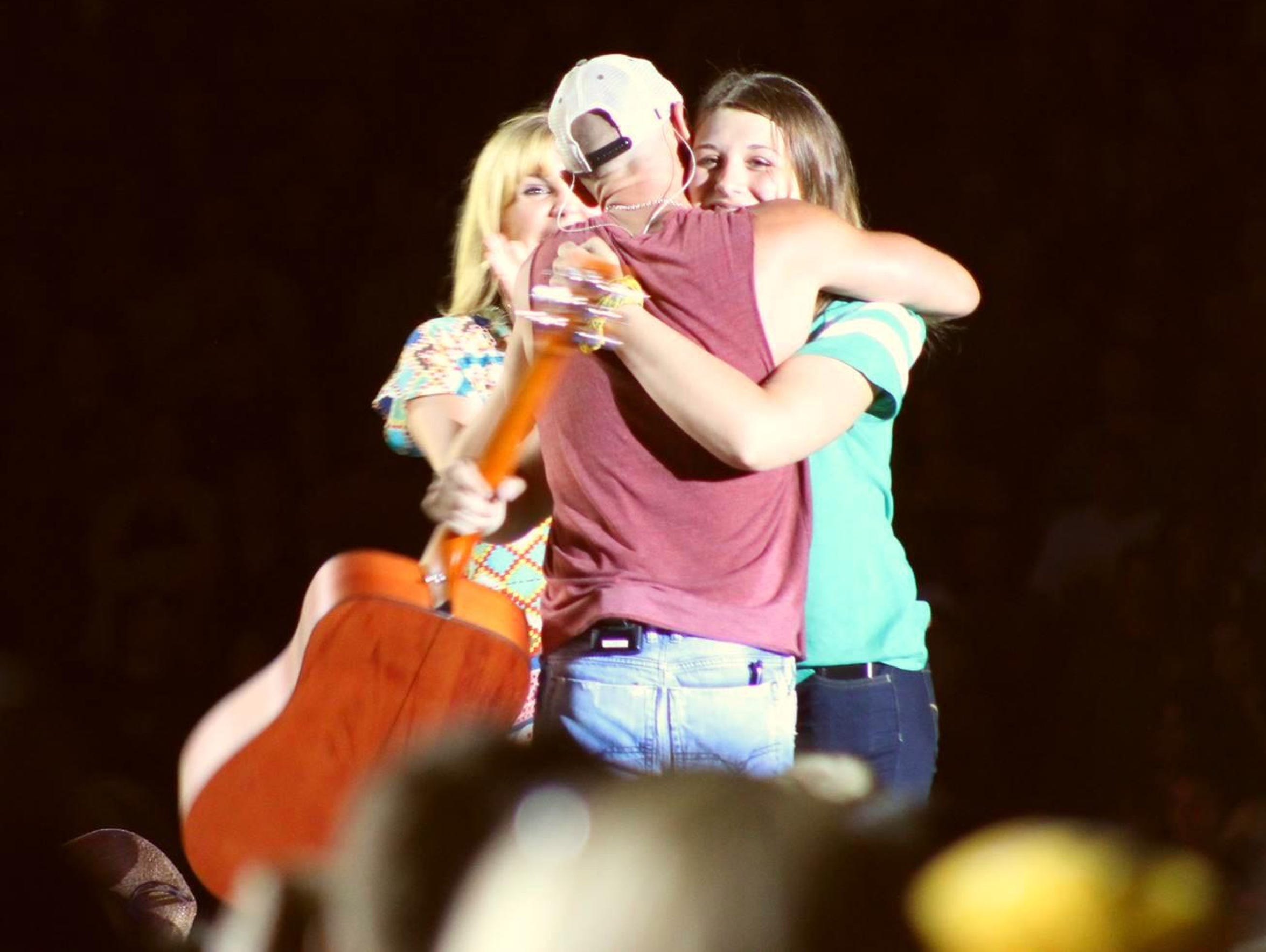 Jenna Terek, right, gets a hug from Kenny Chesney as