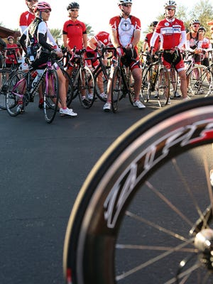 Cyclists gather at Palm Desert Civic Center Park on Sunday, February 15, 2015 in Palm Desert and wear red during the Ride Red for Rose memorial bike ride, which was held in memory of cyclist Rose Peters.