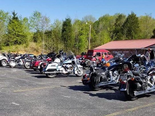 Nearly 50 motorcyclists parked their bikes outside