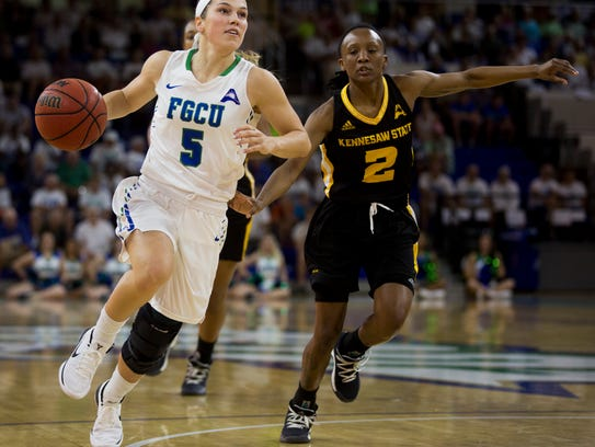 FGCU's Lisa Zderadicka (5) drives against Kennesaw State's Kamiyah Street (2) during the first half at Alico Arena on Monday in Fort Myers. FGCU went on to win 78-51 and clinched the No. 1 seed in the Atlantic Sun tournament.