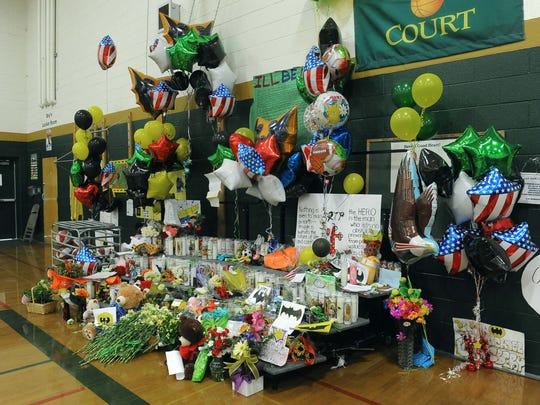 A memorial set up for teacher Michael Landsberry inside the Sparks Middle School gym on Oct. 24, 2013.