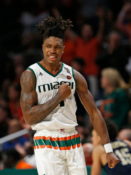Miami guard Lonnie Walker IV celebrates after scoring during the second half of an NCAA college basketball game against Pittsburgh, Wednesday, Jan. 31, 2018, in Coral Gables, Fla. Miami defeated Pittsburgh 69-57. (AP Photo/Wilfredo Lee)