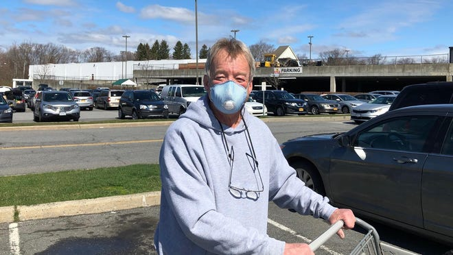 Steve Capping of Newburgh wears a mask while shopping Saturday.