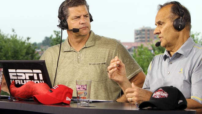 Hall of Fame catcher and manager Joe Torre (right) talks with Mike Golic on ESPN'S Mike and Mike show broadcast live from the Moerlein Lager House.