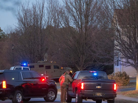 State police in a SWAT-style vehicle sit at the end of Primrose Drive.