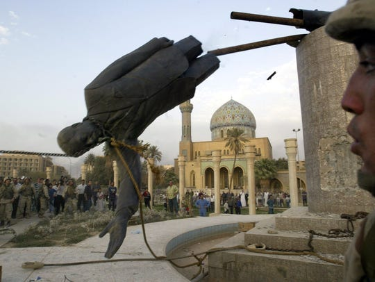 The toppled statue of Saddam Hussein is seen in in Firdos Square downtown Baghdad in this April 9, 2003, file photo.