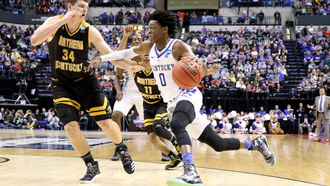 Kentucky Wildcats guard De'Aaron Fox (0) drives past Northern Kentucky Norse forward Drew McDonald (34) during the first half of the NCAA Men's Basketball Championship in Indianapolis on Friday March 17, 2017. UK won 79-70.