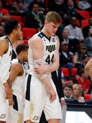 Purdue center Isaac Haas (44) fractured his right elbow