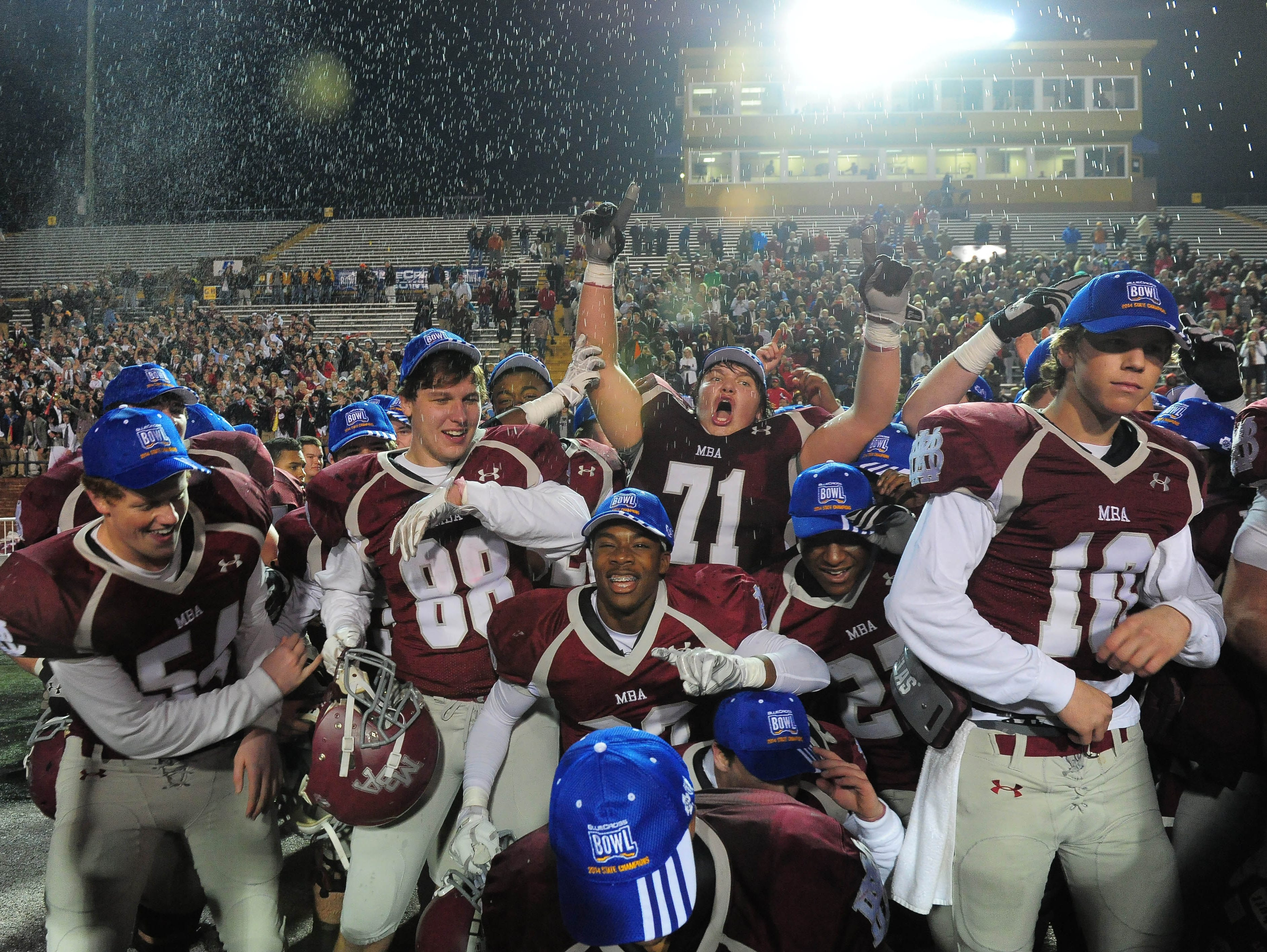 Montgomery Bell Academy player s celebrate their 2014 BlueCross Bowl win over Ensworth.