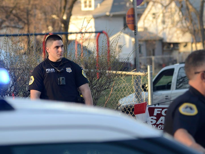 Des Moines police officers investigate a shooting Monday