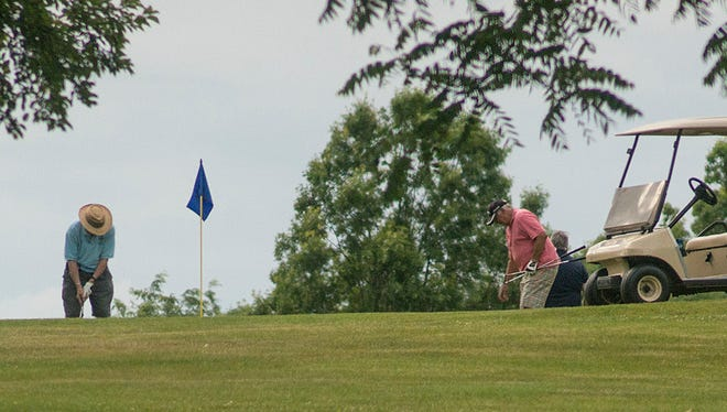 Golfers enjoy a round of golf Thursday at Hilltop. A financial audit projects the golf course to lose nearly $318,000 during a seven-year period ending in 2020.