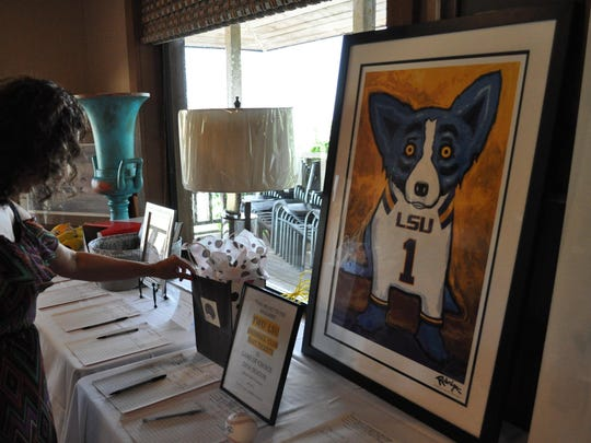 A Blue Dog painting by George Rodrigue was one of the items in Sunday's silent auction for the Hope House.