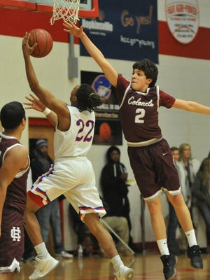 Henderson County's Corey Stewart tries to block the shot of Christian County's Eric Brody in the first half of Saturday's game at Christian County High School in Hopkinsville