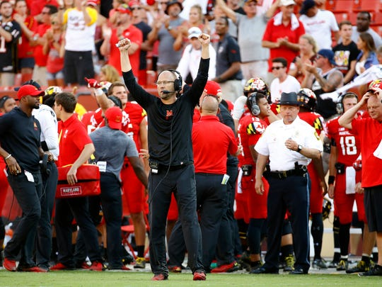 FILE - In this Sept. 1, 2018, file photo, Maryland interim head coach Matt Canada, center, gestures in the final moments of an NCAA college football game against Texas, in Landover, Md. Making the best of a bad situation, Maryland is unbeaten after two games and garnering votes in the Top 25 poll while playing for fallen teammate Jordan McNair and without head coach DJ Durkin.  (AP Photo/Patrick Semansky, File)