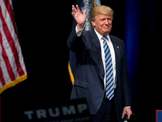 Donald Trump walks onto the stage during a campaign