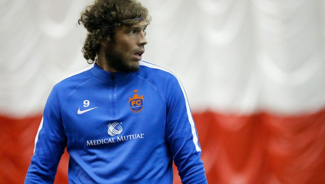 FC Cincinnati midfielder Tommy Heinemann runs through a drill during an FC Cincinnati practice session at the University of Cincinnati's Sheakley Athletic Complex in Cincinnati on Wednesday, Jan. 17, 2018.