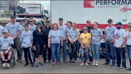 South Dakota Pork Producers Council members helped distribute 13,000 pounds of pork in Aberdeen on May 22.