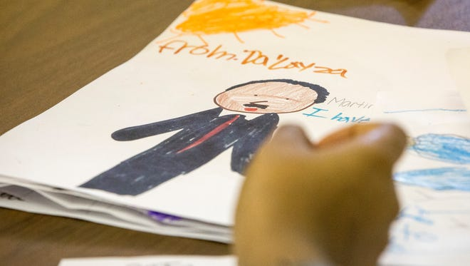 A child draws a picture of Martin Luther King Jr. during a past MLK Jr. Day observance in Muncie.