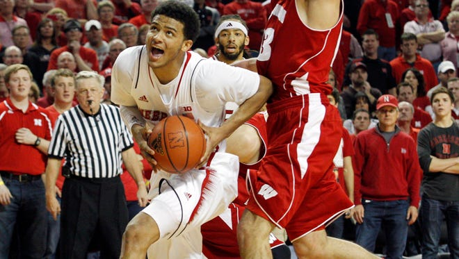 Nebraska Cornhuskers guard Shavon Shields drives past Wisconsin Badgers forward Duje Dukan in the first half at Pinnacle Bank Arena.