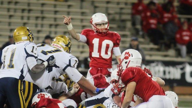 Beechwood quarterback Brayden Burch, 10, lobbies for a first down call.