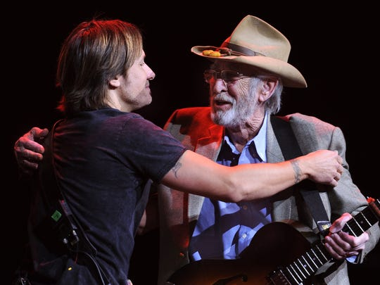 Keith Urban and Don Williams embrace after they performed together during the We're All for the Hall Concert benefiting the Country Music Hall of Fame and Museum at the Bridgestone Arena Tuesday, April 10, 2012 in Nashville, Tenn.