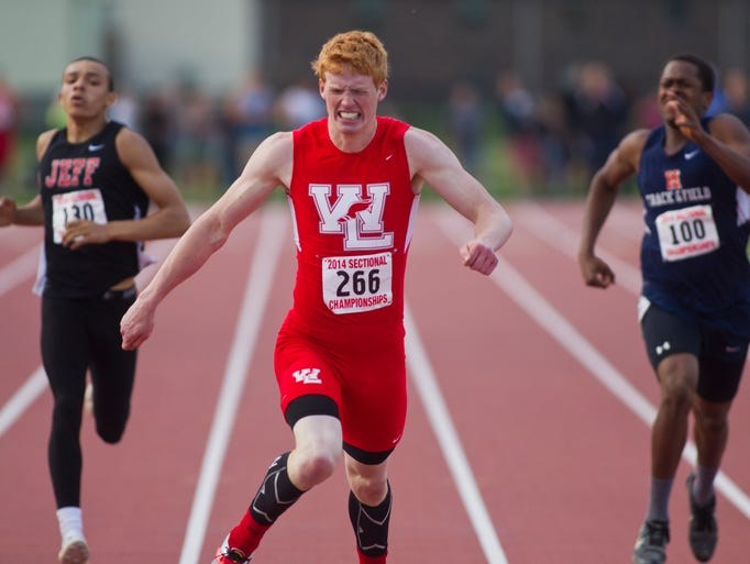 West Lafayette's Brandon Watts stretches for the finish line in the 400 meter dash at the Boys Sectional Tack Thursday, May 22, 2104, at Lafayette Jeff in Lafayette. Watts won the event with a time of 50.00.