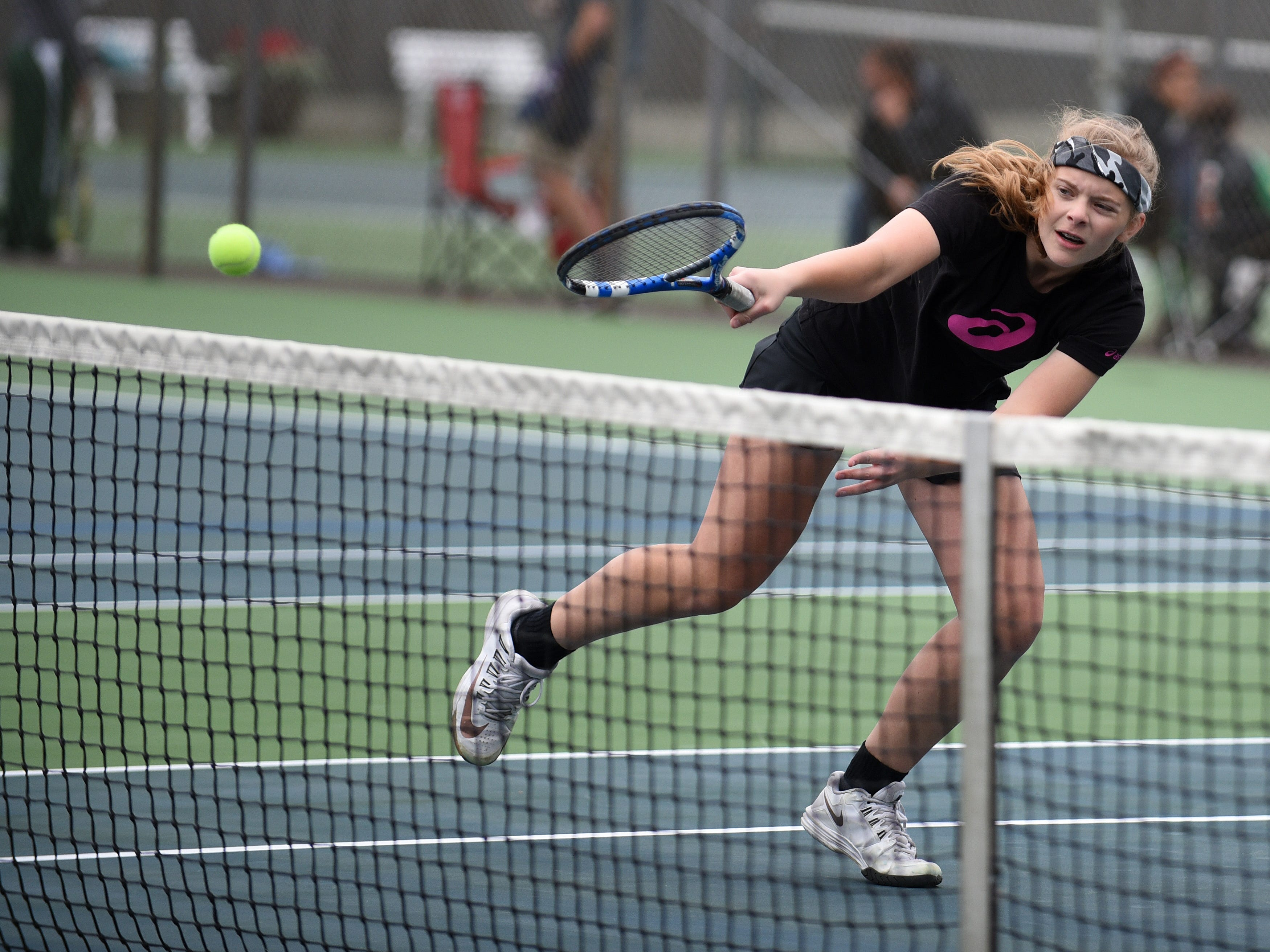 McNary's Hannah Childress plays in a doubles match during the second day of the Greater Valley Conference tennis meet on Friday, May 15, 2015, at Salem Tennis and Swim Club.
