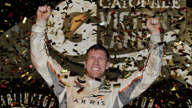 Carl Edwards celebrates in victory lane after winning a NASCAR Sprint Cup auto race at Darlington Raceway, Sunday, Sept. 6, 2015, in Darlington, S.C.