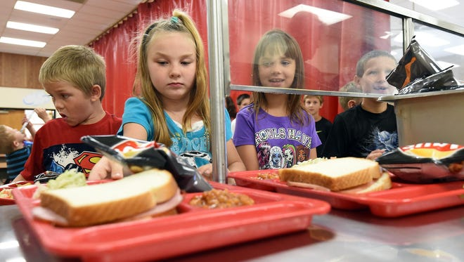 Norfork Elementary School students grab lunch on Thursday. Between Mountain Home, Cotter, Norfork, Flippin and Yellville-Summit schools, the percentage of students on free or reduced-price lunch ranges from 54 to 81 percent.