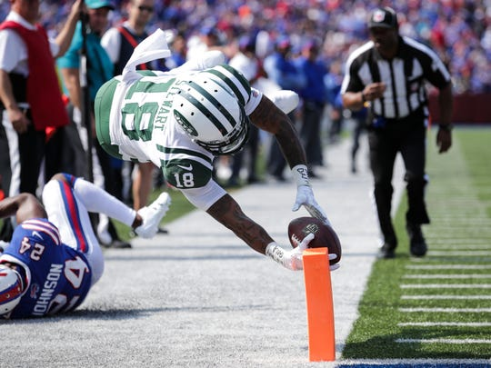 ORCHARD PARK, NY - SEPTEMBER 10:  Chad Hansen #18 of the New York Jets dives for a touchdown as Leonard Johnson #24 of the Buffalo Bills watches during the second half on September 10, 2017 at New Era Field in Orchard Park, New York.  (Photo by Brett Carlsen/Getty Images)