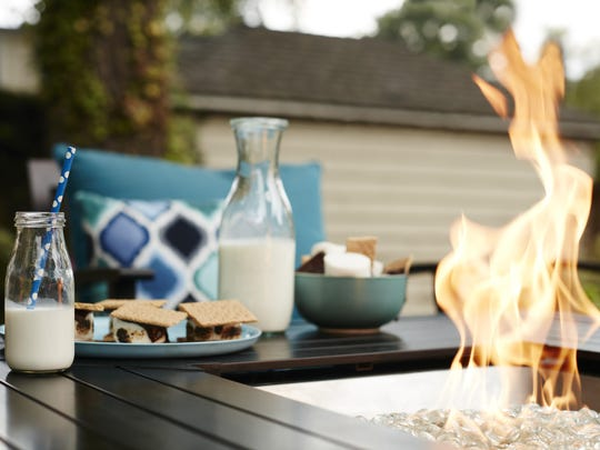 The bronze aluminum propane gas fire table for $599.