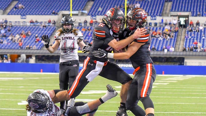 East Central quarterback Alex Maxwell (12) scores the game winning touchdown late in the 4th quarter to beat Lowell 14-7 in the IHSAA State Final, Lucas Oil Stadium, Indianapolis, IN, Saturday, Nov. 25, 2017