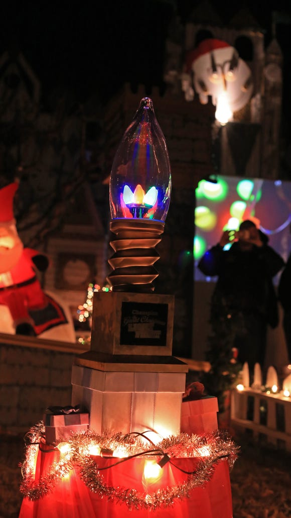 """The Kuhn family won this trophy on ABC's """"The Great Christmas Light Fight"""" for their decorated home on Heritage Drive in St. George."""