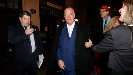 """Tony Sirico, center, who played the role of Paulie """"Walnuts"""" Gualtieri in the cable series The Sopranos, arrives at the Asbury Park Conventional Hall during red carpet arrivals prior to the New Jersey Hall of Fame inductions, Thursday in Asbury Park, N.J. James Gandolfini, who played the lead role in The Sopranos, will be inducted in to the hall of fame during the event."""