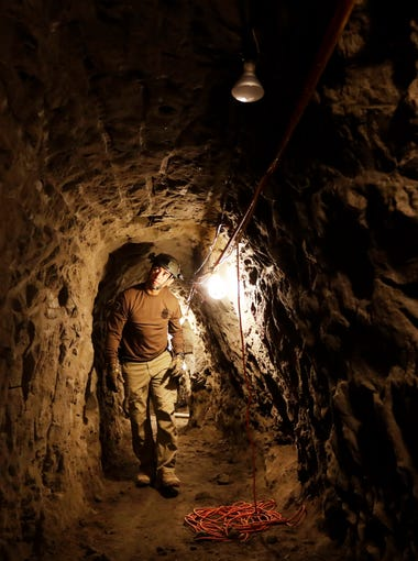 "In this March 6, 2017, photo, a member of the Border Patrol's Border Tunnel Entry Team walks in a tunnel in San Diego that spans the border between the California city and Tijuana, Mexico. Team members are known in the Border Patrol as ""tunnel rats"" — agents who go in the clandestine passages that have proliferated on the U.S.-Mexico border over the last 20 years to smuggle drugs."