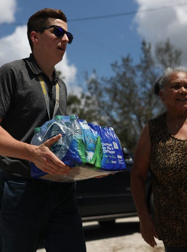 Pilot Dylan Leoni helps to hand deliver supplies, including water, childcare products and food for residents of LaBelle, Fla. where stores and gas stations have been slow to recover from Hurricane Irma. LaBelle, a rural town just inland from Fort Myers, is home to a population of less than 5,000, many of which are migrant farm workers with few resources.