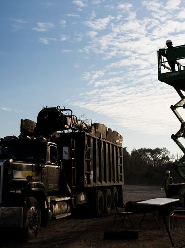 A truck unloads collected debris at Wednesday, March. 14, 2018 in Aransas County.