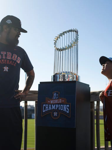 Rico Cano (left) and his son Uriyah Cano, 8, admire the Houston Astros World Series trophy on Monday, April 16, 2018 at Whataburger Field.