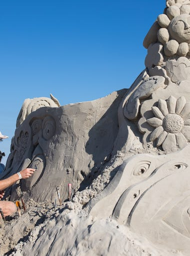 Emerson Schreiner of Grand Rapids, Michigan, works to construct a sand sculpture at Sandfast in Port Aransas on Saturday, April 28, 2018.