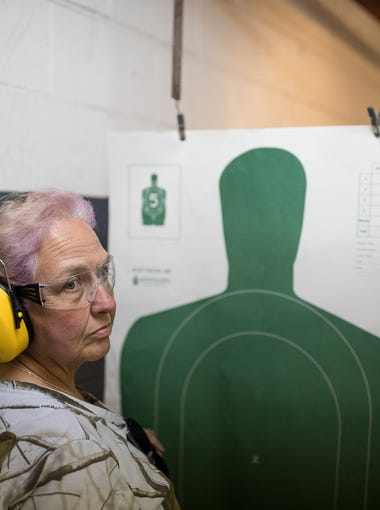 Terry Gallub-Croft of Santa Fe Texas, waits for instruction  as she takes a license to carry class at Big Kountry Shooting in  Alvin, TX on Saturday, May 19, 2018. The day after a shooting that left 10 dead at Santa Fe High School.