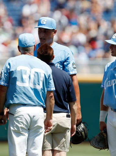 Jun 16, 2018; Omaha, NE, USA; North Carolina Tar Heels trainer talks to pitcher Gianluca Dalatri (42) in the game against Oregon State Beavers in the first inning during the College World Series at TD Ameritrade Park. Mandatory Credit: Bruce Thorson-USA TODAY Sports ORG XMIT: USATSI-381892 ORIG FILE ID:  20180616_kek_st5_046.JPG