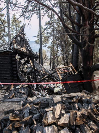 """A home that was destroyed in the Cranston Fire is taped with a """"do not enter"""" tape after county officials inspected it on Sunday July 29, 2018."""