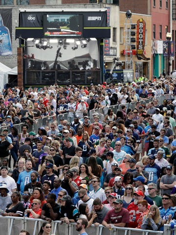 FILE - In this April 27, 2019, file photo, fans attend the final day of the NFL football draft in Nashville, Tenn. In a memo sent to the 32 teams Monday and obtained by The Associated Press, NFL Commissioner Roger Goodell outlined procedures for the April 23-25 draft. The guidelines include no group gatherings. (AP Photo/Mark Humphrey, File)
