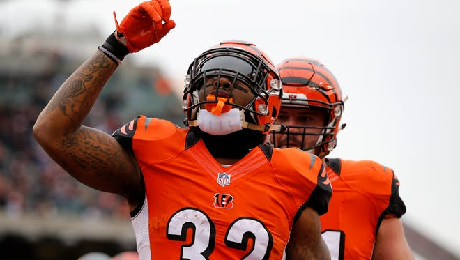 Cincinnati Bengals running back Jeremy Hill (32) celebrates after a touchdown in the first quarter of the NFL Week 13 game between the Cincinnati Bengals and the Philadelphia Eagles at Paul Brown Stadium in downtown Cincinnati on Sunday, Dec. 4, 2016.